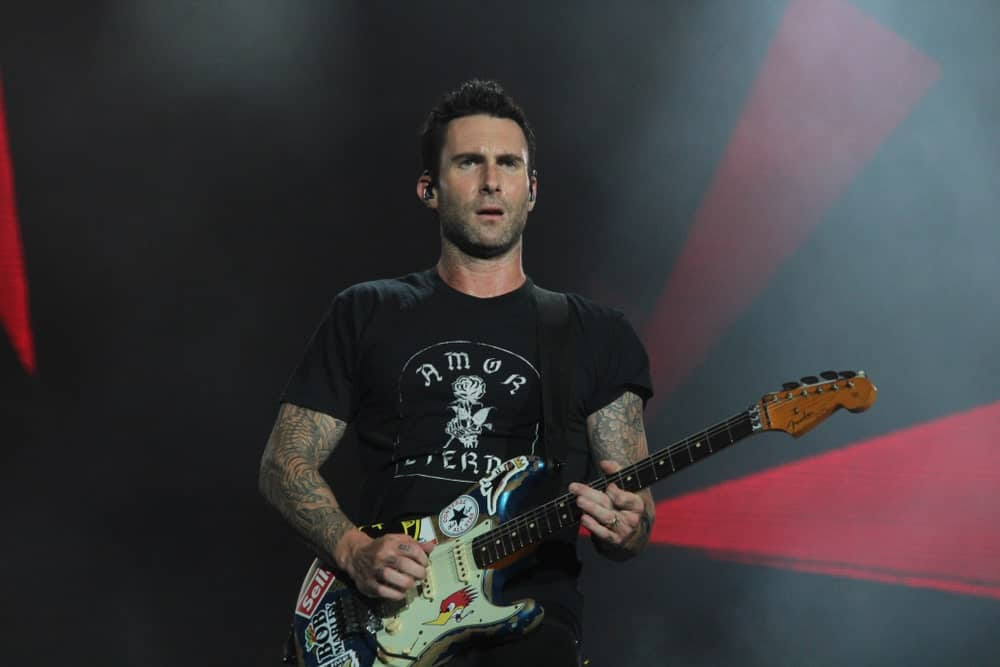 Adam Levine performed on stage at the Rock In Rio Festival on September 15, 2017. He looked sexy and carefree in his black printed shirt, five o'clock shadow and brushed up fade hairstyle.
