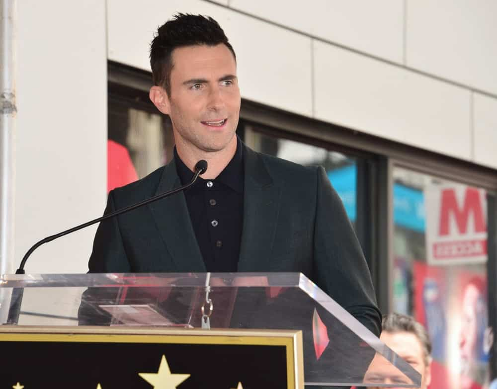 On February 10, 2017, singer Adam Levine was honored at the Hollywood Walk of Fame with his own Star Ceremony. He wore smart casual charcoal jacket with his iconic spiky fade hairstyle.