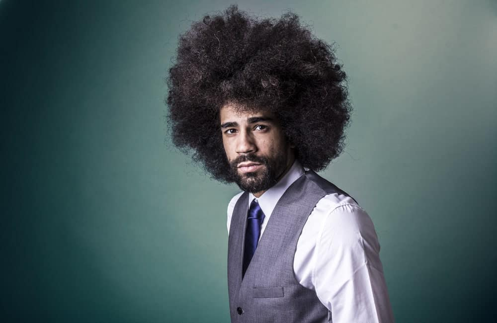 Afro, often referred to as 'fro, is a hairstyle that can be used by both men and women, although it is a much popular choice for men. Afro hairstyle can be done to short or even long hair.
