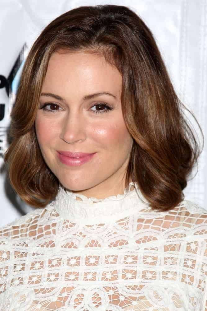 "Alyssa Milano looked fresh in medium-length loose waves at the Drop in the Bucket ""Cause on the Rocks"" Fundraiser on October 19, 2010. She finished the look with a white lace dress and a light makeup."