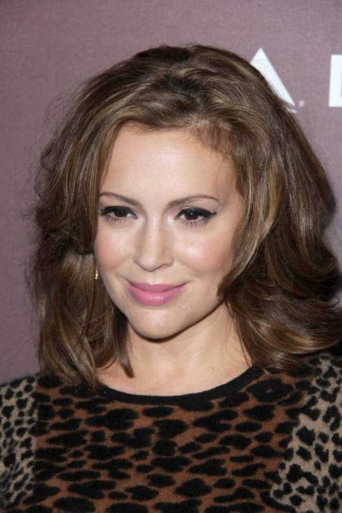 Replicate this messy but voluminous medium-length layers Alyssa Milano wore at the Hollywood Reporter's Next Gen 20th Anniversary Gala on November 6, 2013.