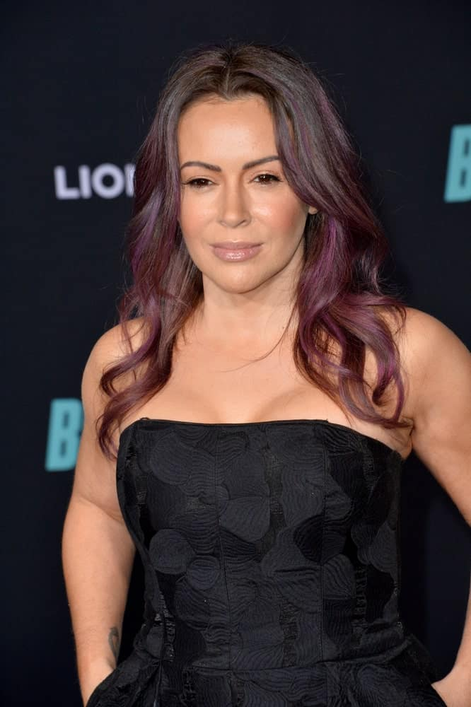 "Alyssa Milano showcased a center-parted wavy hairstyle that's accentuated with purple hues during the premiere of ""Bombshell"" at the Regency Village Theatre on December 11, 2019."