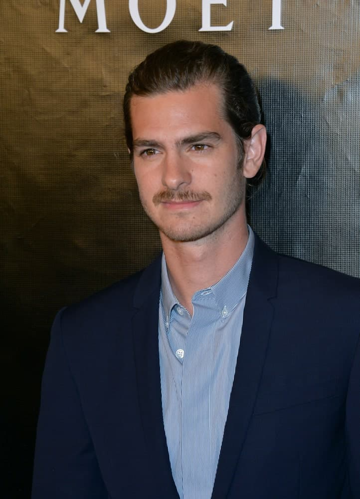 Andrew Garfield showed off his manly charm in a man bun that's paired with a mustache during the Hollywood Foreign Press Association's Grants Banquet at the Beverly Wilshire Hotel on August 13, 2015.