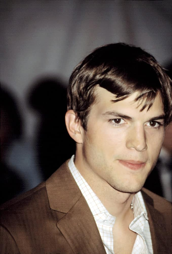 Ashton Kutcher wore a dapper tan suit with his short and tousled hairstyle with a slight side-parted finish at the Metropolitan Museum of Art Goddess Gala in New York on April 28, 2003.