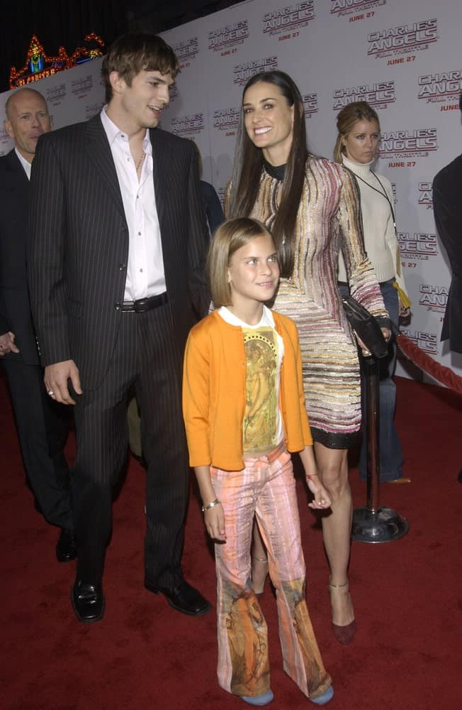 Actor Ashton Kutcher's pin-striped suit was a nice complement to his highlighted fringe hairstyle at the Hollywood premiere of Demi Moore's new movie Charlie's Angels: Full Throttle on June 18, 2003.