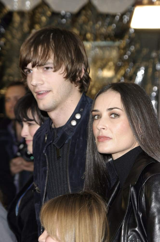 Ashton Kutcher's long and layered fringe was paired with a black casual outfit at the