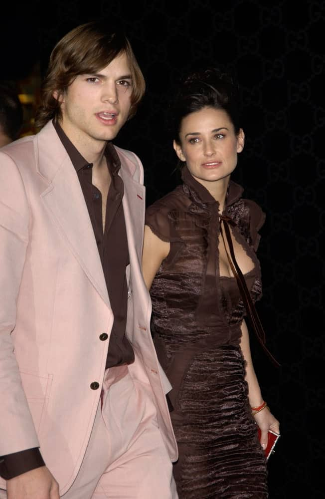 Ashton Kutcher's long and flowing dark brown hairstyle was side parted and paired well with his pink suit at the Rodeo Drive Walk of Style Gala honoring Gucci's Tom Ford on March 28, 2004.