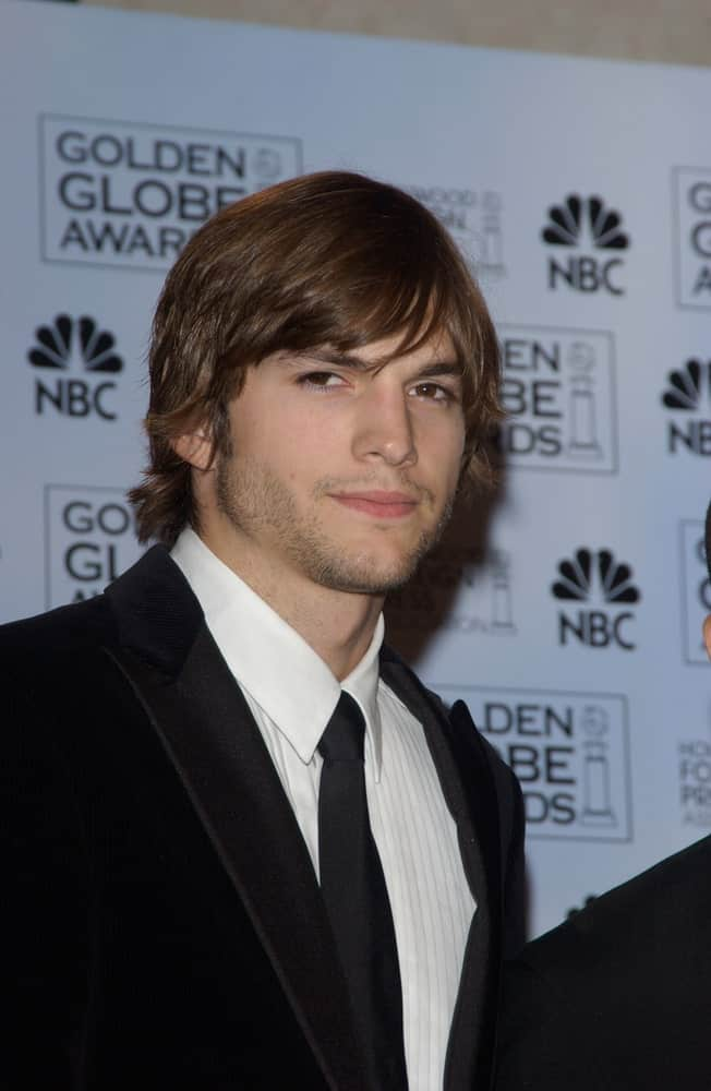Ashton Kutcher's classy black suit was complemented by his long side-parted hairstyle and confident eyes at the 61st Annual Golden Globe Awards at the Beverly Hilton Hotel, Beverly Hills, CA on January 25, 2004.