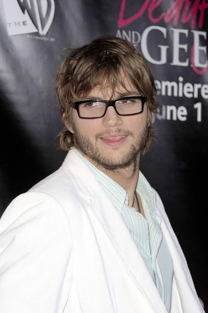Ashton Kutcher looked amazing with his spectacles that complemented his tousled fringe hairstyle and trimmed beard at The WB Premiere of Beauty & The Geek in Geisha House, Los Angeles on May 25, 2005.