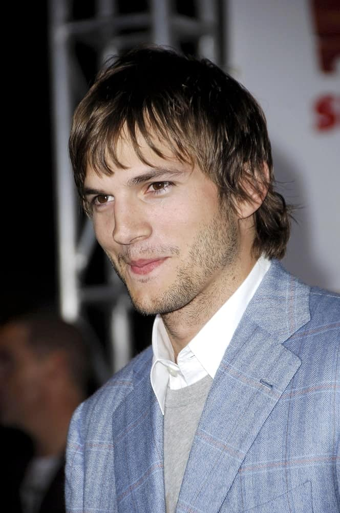 Ashton Kutcher went with a tousled fringe that has a mullet at the