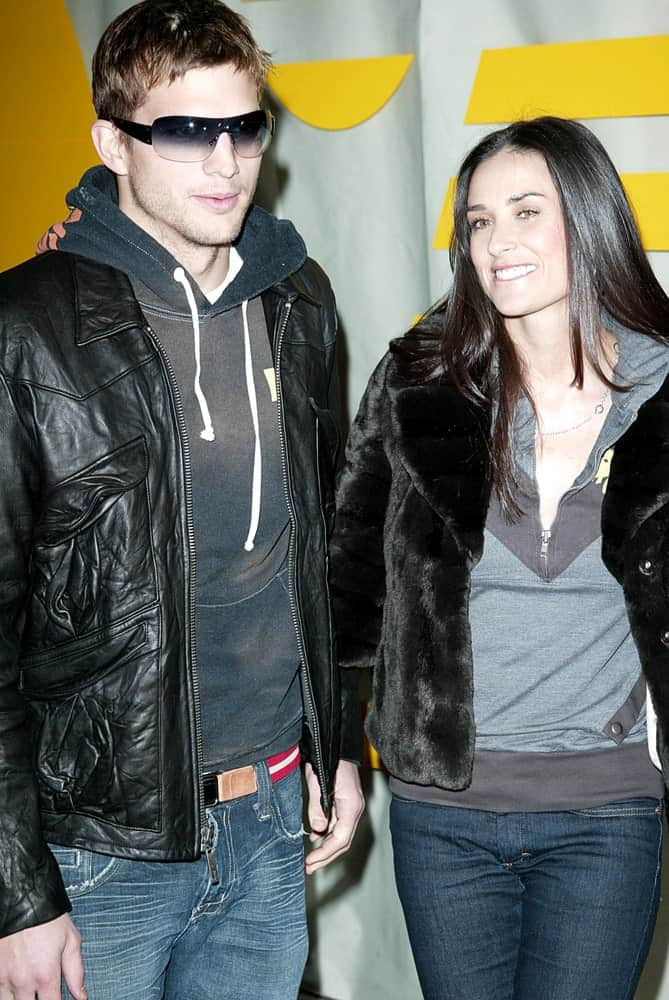 Ashton Kutcher and Demi Moore were at Rebel Yell Clothing Launch Party in Kitson, Los Angeles on February 19, 2006. They were both in casual winter outfits with Kutcher wearing cool sunglasses and a tousled Caesar hairstyle.