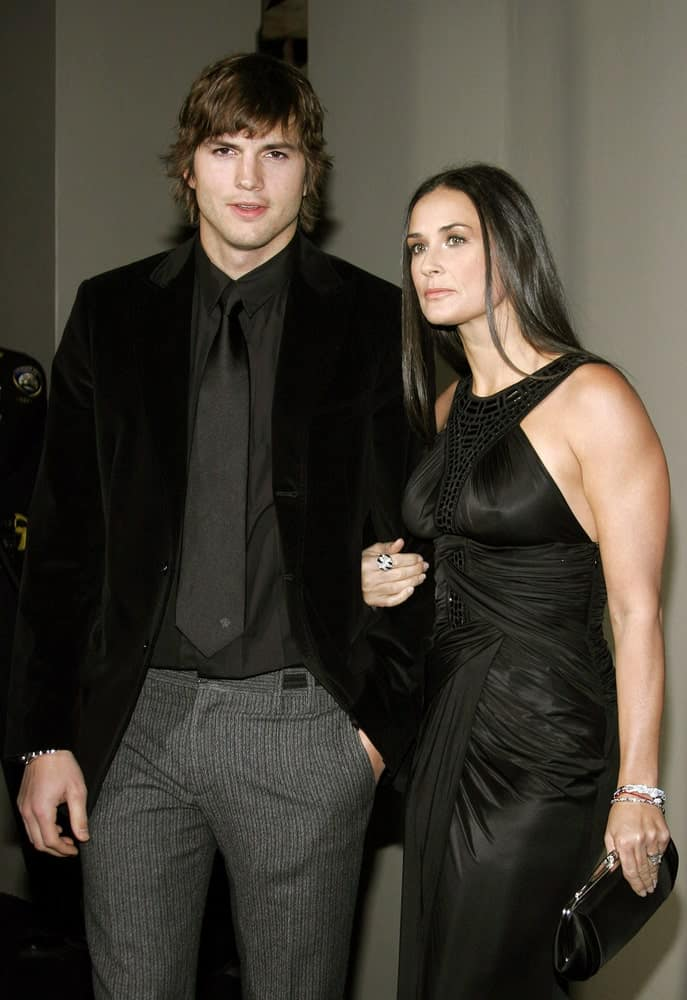 Ashton Kutcher attended the Rodeo Drive Walk Of Style Award honoring Gianni and Donatella Versace in Beverly Hills, California on February 8, 2007. He wore a stylish black suit with his tousled and flippy long hair.