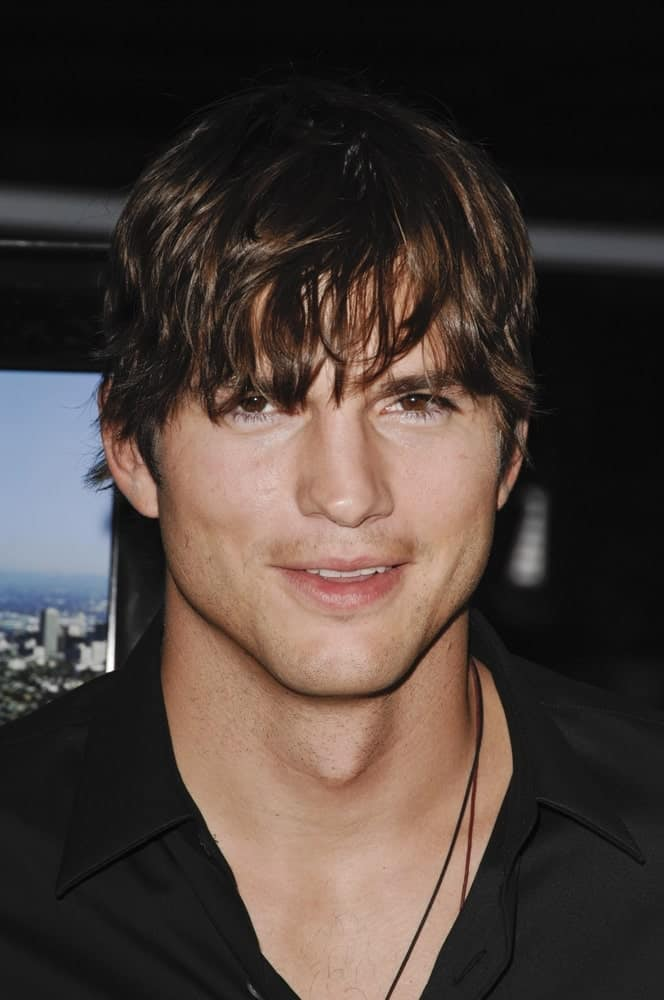 Ashton Kutcher's eye curtain bangs and highlighted fringe hairstyle was paired with his black button-down shirt at the SPREAD Premiere, ArcLight Cinemas Hollywood in Los Angeles, CA on August 3, 2009.