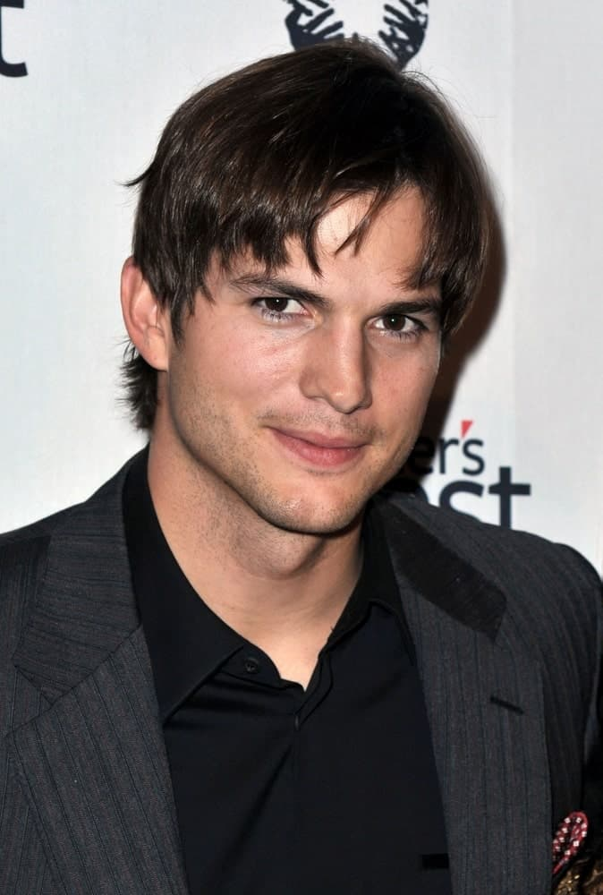 Ashton Kutcher had a short center-parted hairstyle that complemented his beautiful eyes and black suit at the Half the Sky Turning Oppression into Opportunity for Women Worldwide Book Party in New York on September 23, 2009.