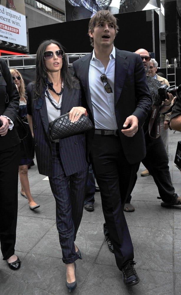 Demi Moore and Ashton Kutcher attended the Entertainment Industry Foundation Kick Off in Times Square, New York on September 10, 2009. Kutcher's elegant suit was balanced by his tousled and highlighted fringe hairstyle.