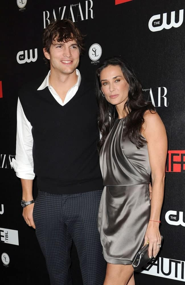 Ashton Kutcher and Demi Moore were at The Beautiful Life premiere party in the Simyone Lounge, New York on September 12, 2009. Kutcher's fashion forward smart casual outfit is a nice complement to his iconic wavy fringe hair.