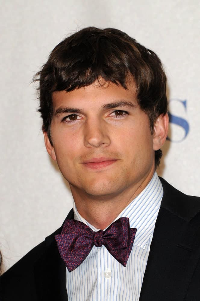 Ashton Kutcher paired his bow tie outfit with a long Caesar hairstyle that has subtle highlights at the 2010 People's Choice Awards Press Room, Nokia Theater in Los Angeles.