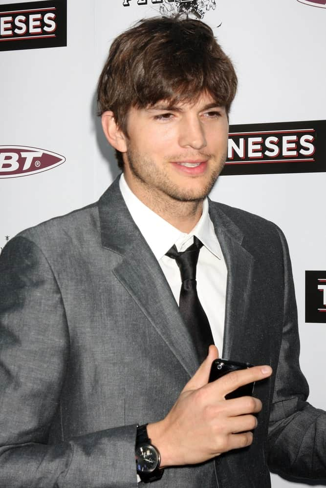 Ashton Kutcher's trimmed beard was a perfect match for his highlighted and tousled fringe hairstyle at the premiere of 'The Joneses' at the ArcLight Theater in Los Angeles, California on April 7, 2010.