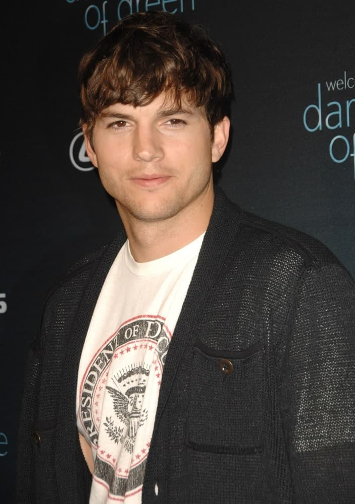 Ashton Kutcher wore a casual shirt and sweater jacket at