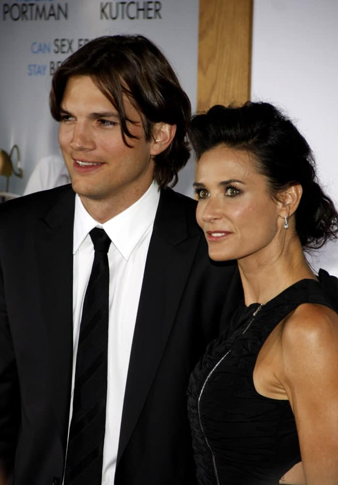Ashton Kutcher and Demi Moore were at the Los Angeles premiere of 'No Strings Attached' held at the Regency Village Theater on January 11, 2011. Kutcher was handsome in his dapper black suit and long highlighted hairstyle.