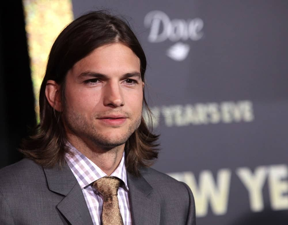 Ashton Kutcher was classy and edgy in his suit and long center-parted hairstyle at the