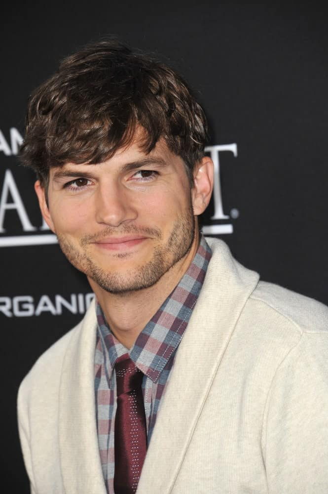 Ashton Kutcher had a short highlighted wavy fringe hairstyle at the Los Angeles premiere of his movie