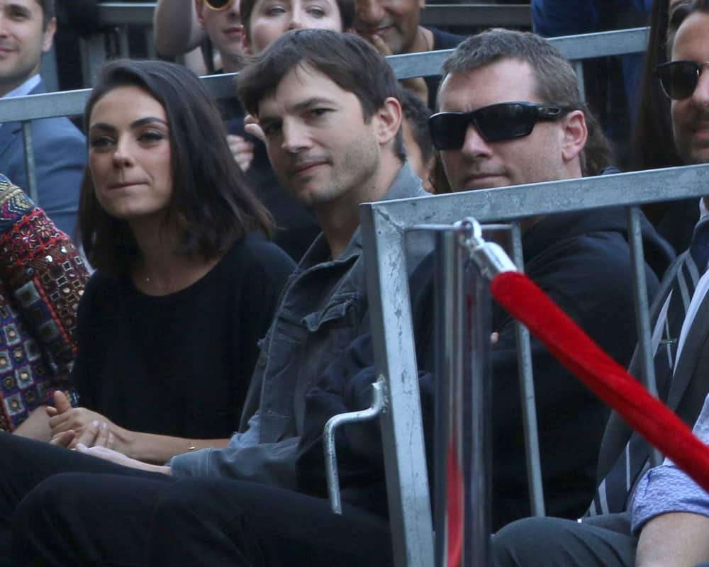 Mila Kunis, Ashton Kutcher and Sam Worthington were at the Zoe Saldana Star Ceremony on the Hollywood Walk of Fame on May 3, 2018 in Los Angeles. Kutcher  wore a casual denim jacket to go with his short side-parted hairstyle.