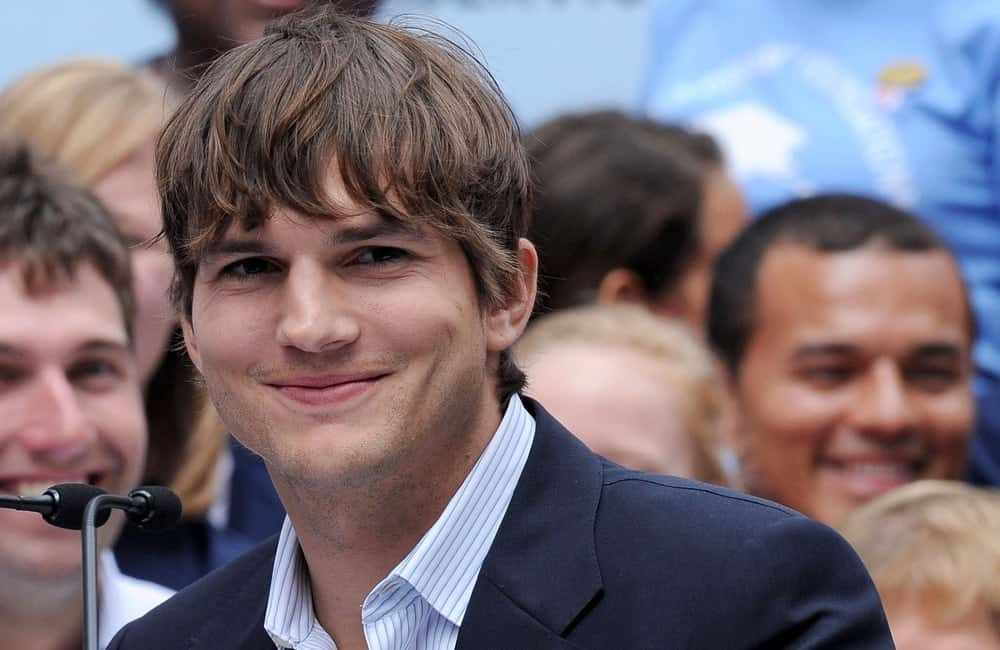 Ashton Kutcher smiles at the press conference for Entertainment Industry Foundation I PARTICIPATE Kick Off Promotes Volunteerism, Times Square, New York September 10, 2009.