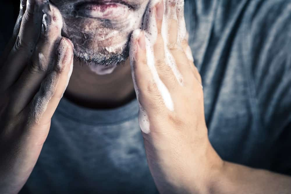Man washing his beard.