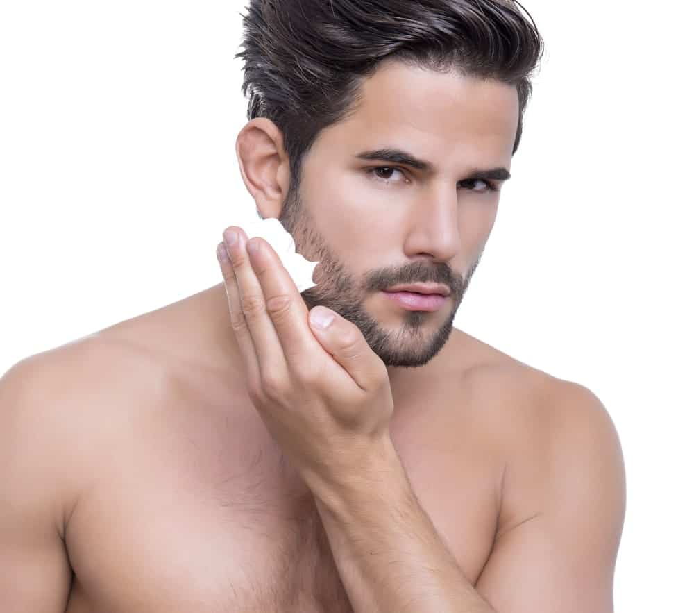 Man applying beard wash.