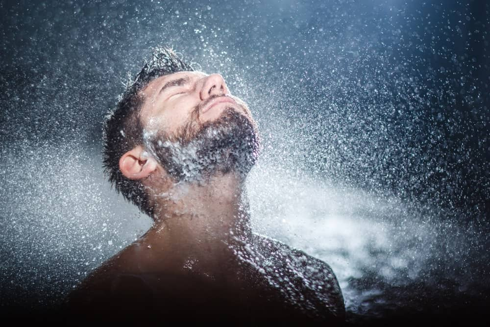 Man taking a shower.