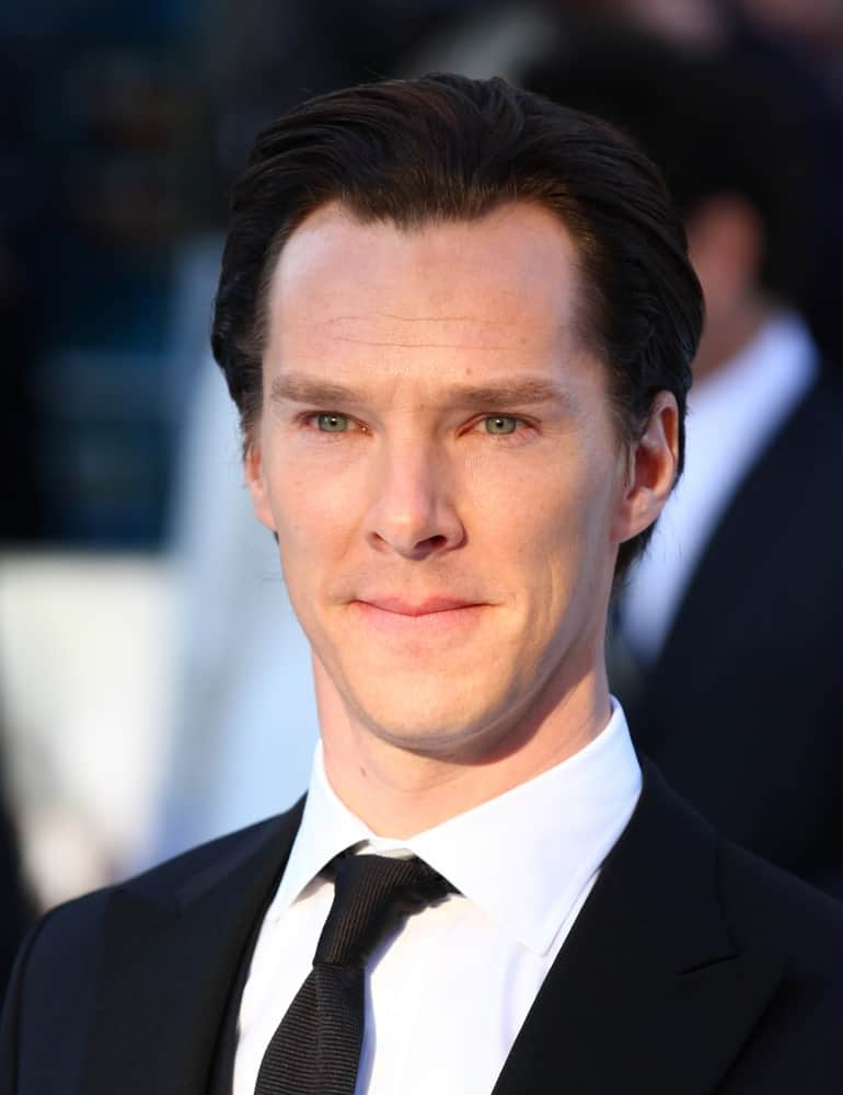 The English actor styled his medium-length black hair in a loose slicked back at the UK Premiere of Star Trek Into Darkness at The Empire Cinema on May 2, 2013.