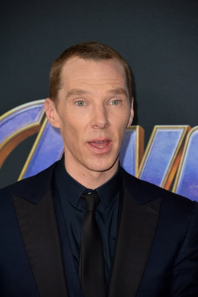 Benedict Cumberbatch looking sharp in a navy blue suit along with a buzz cut hairstyle at the world premiere of Marvel Studios'