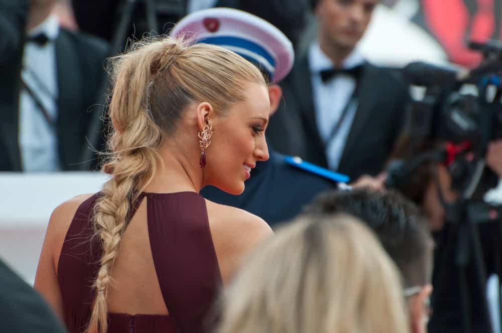 Actress Blake Lively wore her highlighted blond hair with a long braided ponytail during the 67th Annual Cannes Film Festival on May 14, 2014 in Cannes, France.