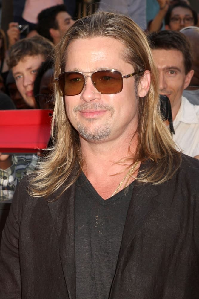 "Brad Pitt attended the premiere of ""World War Z"" in Times Square on June 17, 2013, in New York City. He wore a casual outfit to go with his long highlighted hairstyle and sexy sunglasses."