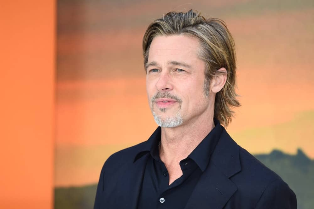 """Last July 30, 2019, Brad Pitt wore an all-black suit and shirt with his long flowing highlighted hair at the UK premiere for """"Once Upon A Time In Hollywood"""" in Leicester Square, London."""