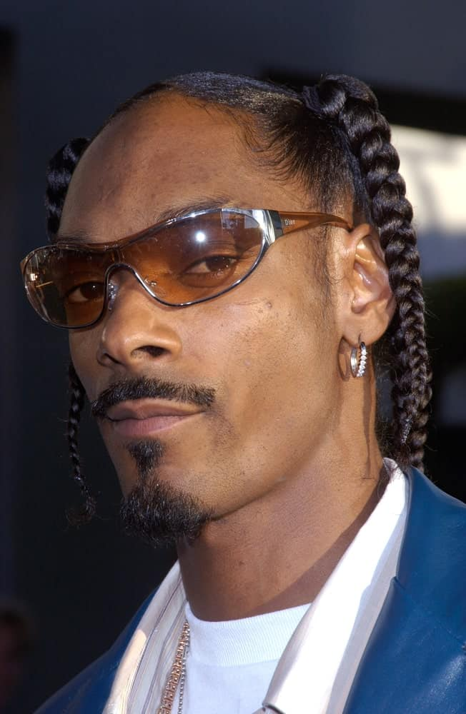 Snoop Dogg have always wear his favorite hairstyle, braids, since his younger days. Here's a look at Snoop during the premier of Catwoman in Hollywood.