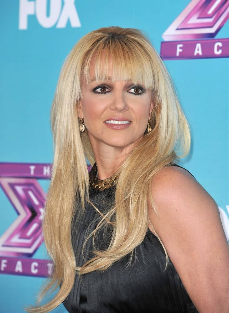 "On December 17, 2012, Britney Spears attended the press conference for the season finale of Fox's ""The X Factor"" sporting a loose wavy hairstyle with blunt bangs."