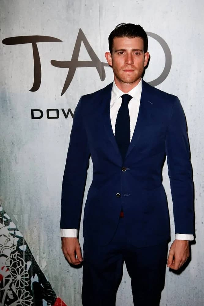 Bryan Greenberg was looking slick and sexy with his classy blue suit and brushed back pompadour hairstyle during the grand opening of TAO Downtown at the Maritime Hotel on September 28, 2013 in New York City.