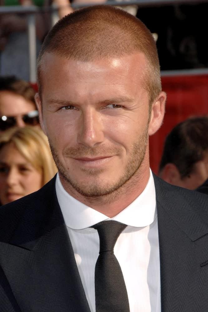 The buzz cut is often referred to as the younger brother of the bald style. Here's David Beckham in a buzz cut, photo taken at the Nokia Theatre L.A. Live during the 2008 ESPY Awards.