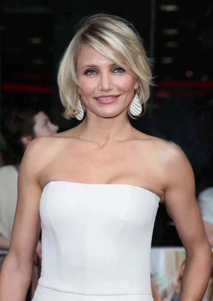 Cameron Diaz wore an all-white ensemble with her tousled bob incorporated with side-swept bangs during the UK Premiere of 'What To Expect When You're Expecting' at the Imax Cinema, London, May 22, 2012.