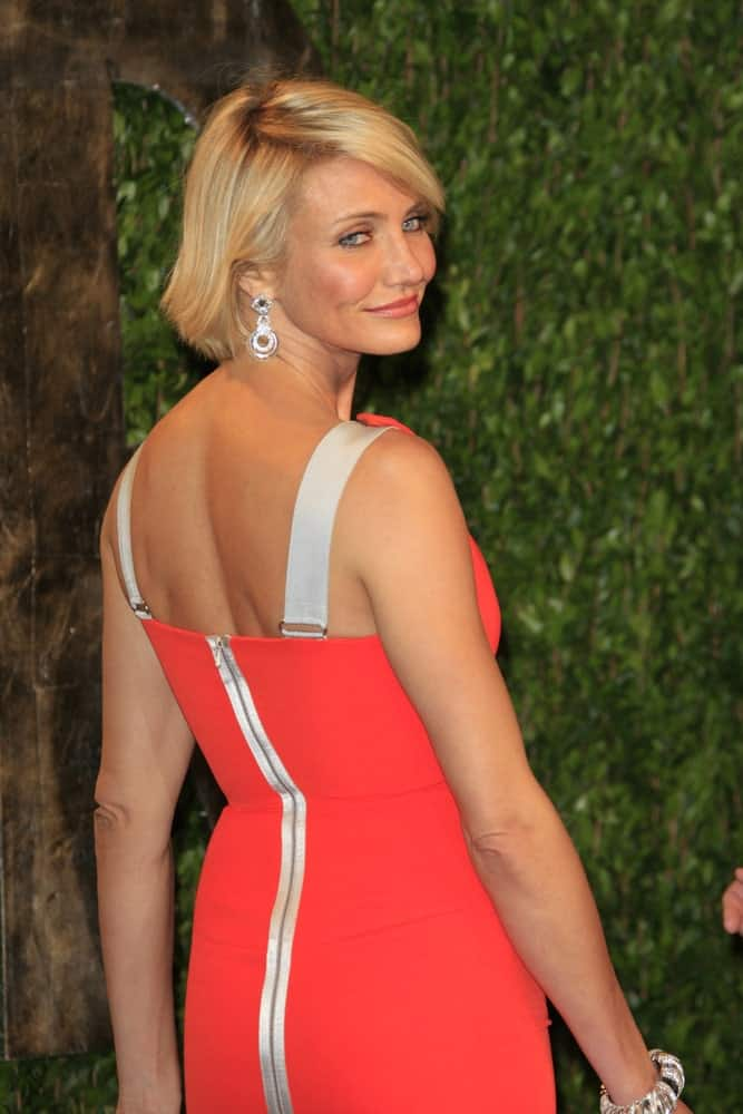 Cameron Diaz's sexy orange dress and and elegant blond bob hairstyle wowed at the Vanity Fair Oscar Party at Sunset Tower last February 26, 2012 in West Hollywood, California.