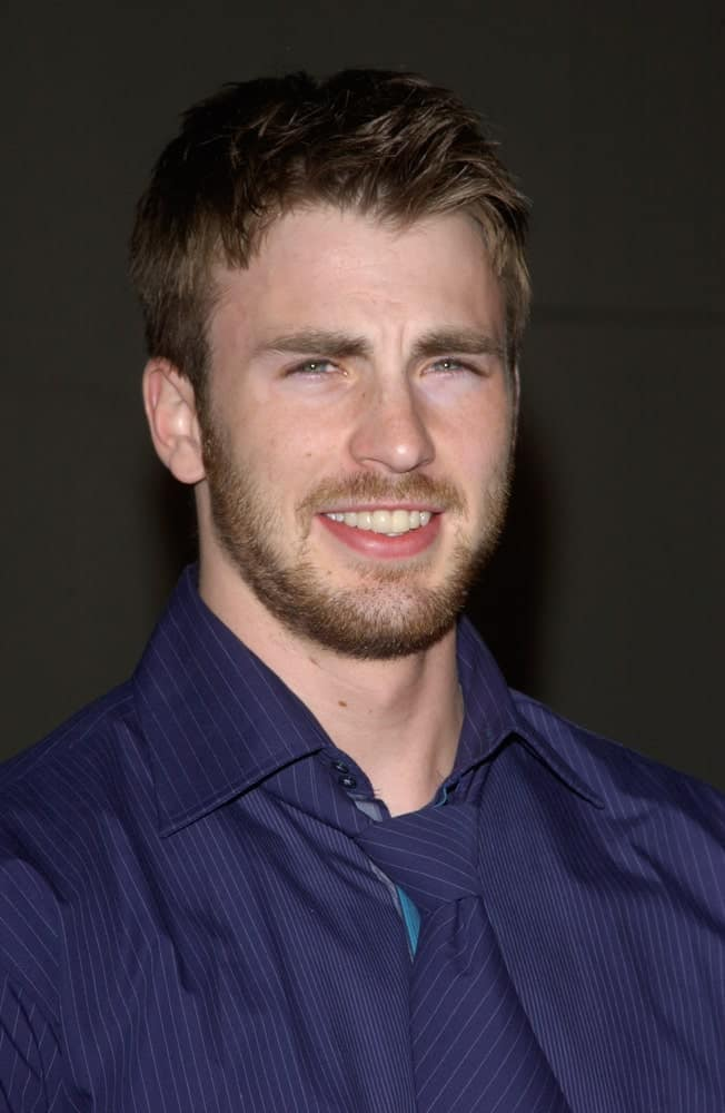 Actor Chris Evans wore a blue button-down shirt with his tousled and spiked fade hairstyle at the world premiere of his new movie