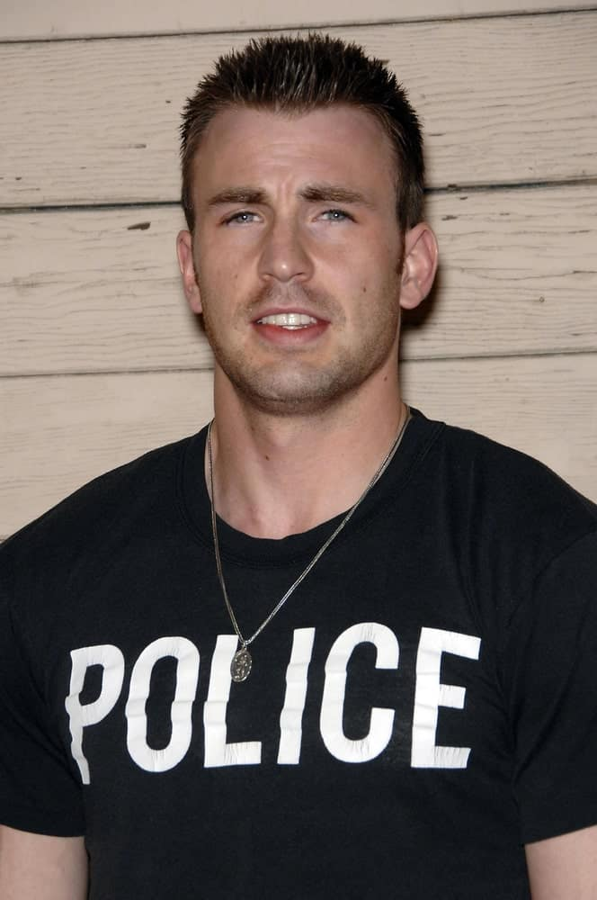 A buff Chris Evans wore a casual black shirt with his short and spiky crew cut hairstyle at The 2008 MAXIM Hot 100 Party held at the Paramount Studio Lot in Los Angeles on May 21, 2008.