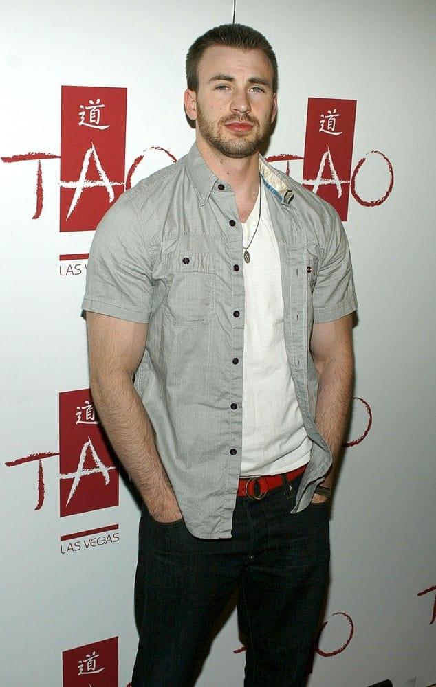 Chris Evans's muscular arms were on full display with his casual outfit paired with a short crew cut hairstyle and trimmed beard at TAO Partner Jason Strauss' Birthday Party in Las Vegas on April 12, 2008.