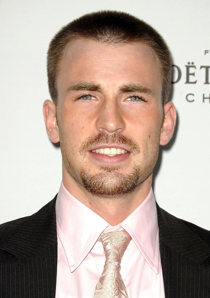 Chris Evans sported a goatee with his buzz cut hairstyle and pick tie at the 15TH Annual ELLE Women in Hollywood Event held at The Four Seasons Beverly Hills in Los Angeles on October 06, 2008.
