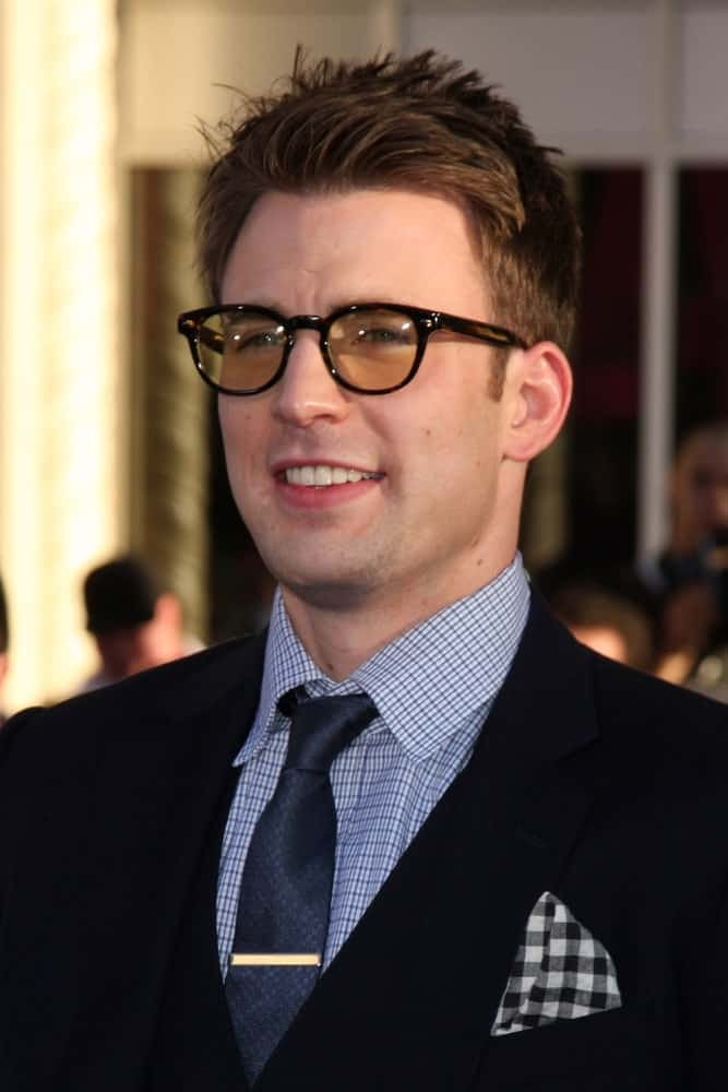 Chris Evans paired his brushed-up and spiked undercut hairstyle with a pair of colored spectacles at the