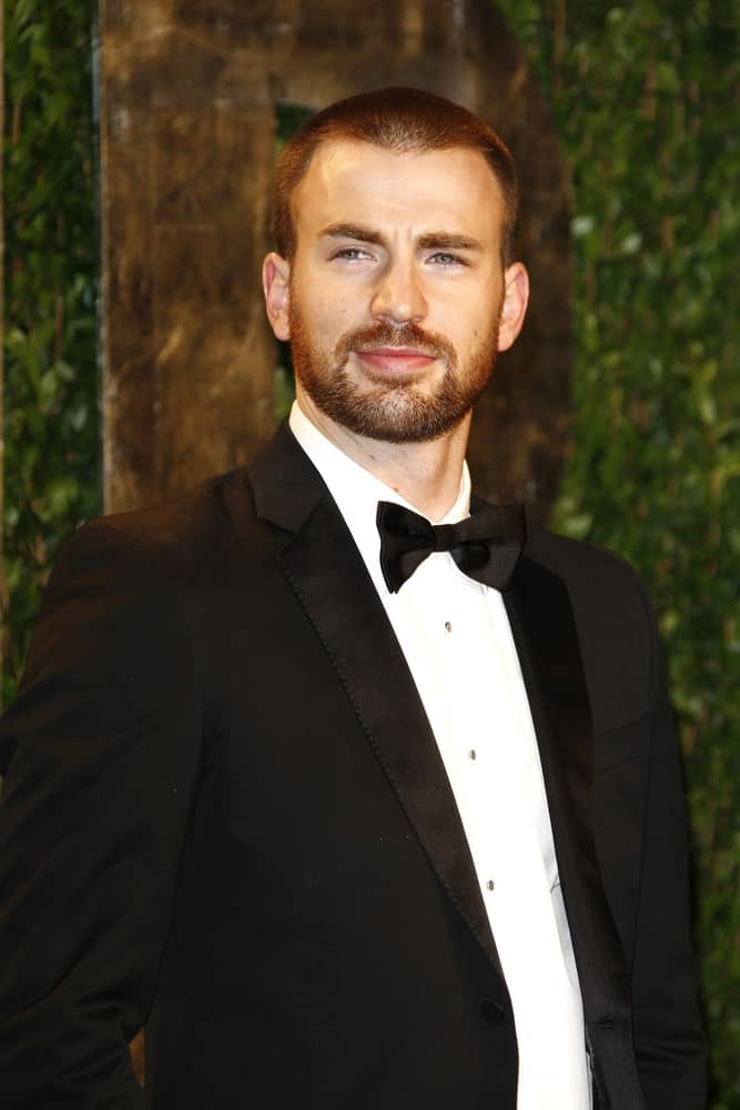 Chris Evans' pulled off this classy look of a buzz cut and trimmed beard with his black tux at the Vanity Fair Oscar Party at Sunset Tower on February 26, 2012 in West Hollywood, California.