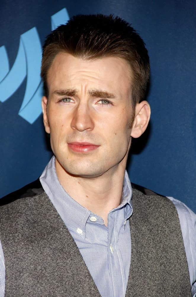 A clean-shaven Chris Evans was at the 24th Annual GLAAD Media Awards at the JW Marriott Los Angeles at L.A. LIVE on April 20, 2013. He wore a smart casual outfit with his spiked crew cut hairstyle.