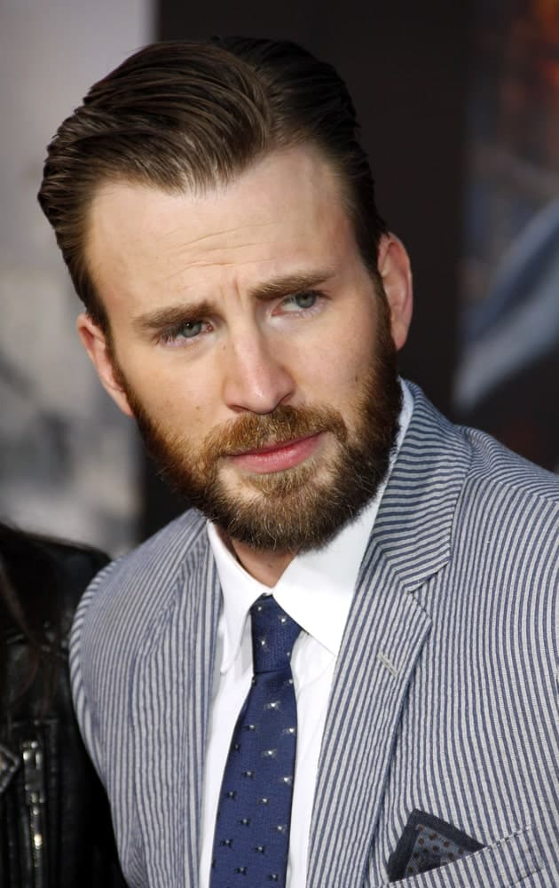 Chris Evans' beautiful full trimmed beard goes perfectly well with his slicked back side-parted hairstyle at the World premiere of Marvel's 'Avengers: Age Of Ultron' held at the Dolby Theatre in Hollywood on April 13, 2015.